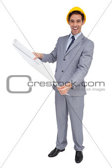 Smiling architect with hard hat holding plans