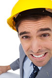 Close up of architect with hard hat grimacing while holding plans