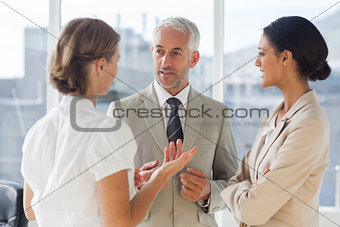 Group of business people discussing together