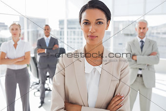Attractive serious businesswoman with arms crossed