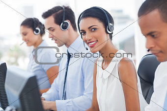 Smiling agent with colleagues sitting