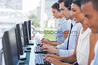 Call centre employees working on computers