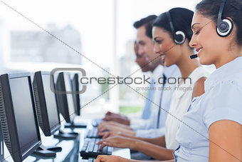 Call centre workers working in line