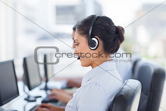 Attractive brunette working in a call centre