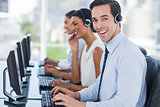 Joyful agent working in a call centre