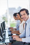 Joyful call centre agent working