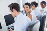Attractive call centre employee looking over shoulder