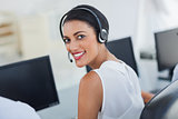 Call centre agent looking over shoulder