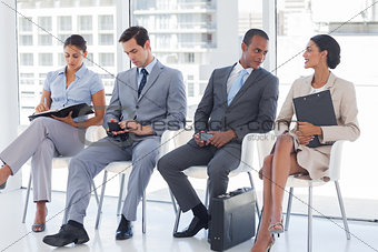 Business people sitting together