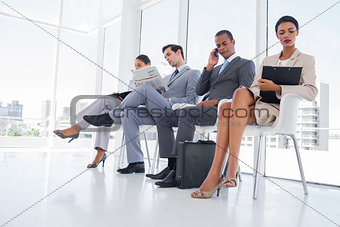 Business people working while waiting