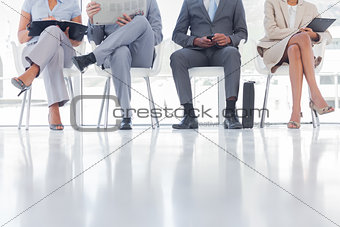 Group of well dressed business people waiting