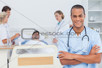 Attractive doctor with arms crossed