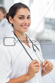 Attractive woman doctor holding her stethoscope