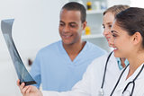 Medical team analysing a radiography