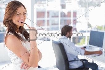Portrait of smiling woman in creative office