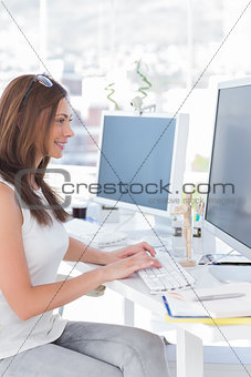 Attractive designer working at her computer
