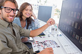 Two smiling photo editors working with contact sheets