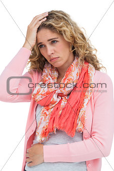Blonde woman having both headache and belly pain