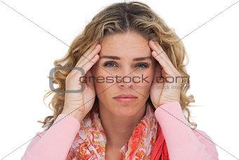 Blonde woman suffering with headache