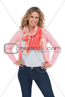 Attractive blonde woman posing with hands on hips