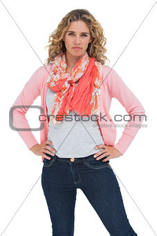 Blonde woman posing with hands on hips