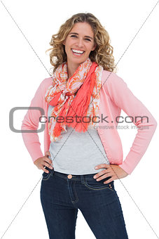 Smiling blonde woman posing with hands on hips