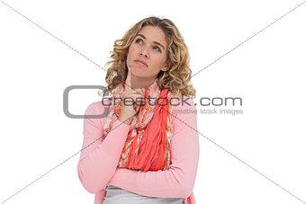 Blonde thoughtful woman posing