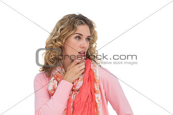 Blonde thoughtful woman posing while touching her chin