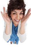 Overhead of surprised woman with hands wide opened