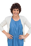 Smiling brunette woman placing hands on hips