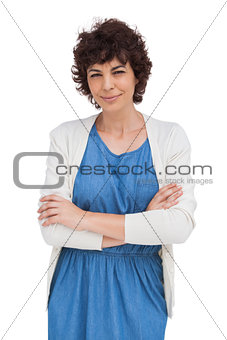 Smiling brunette woman with arms folded