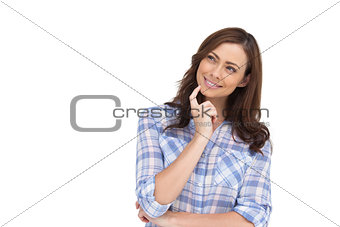 Thoughtful woman placing her finger on her chin