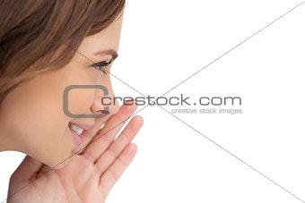 Close up of a brunette woman whispering a secret