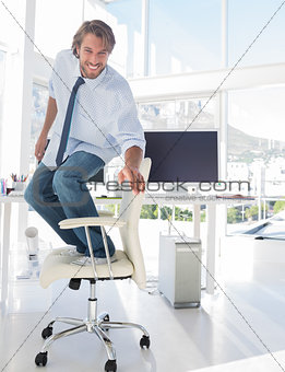 Man surfing his office chair