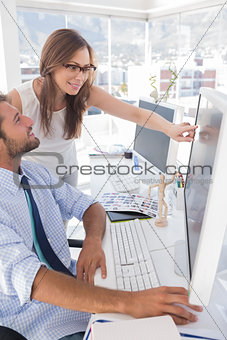 Photo editors looking at computer screen