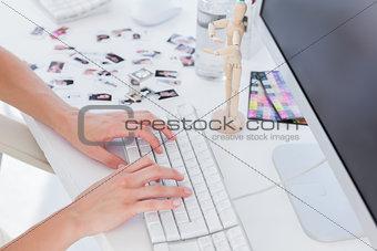 Female editor typing on keyboard