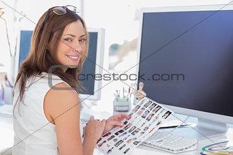 Editor looking over shoulder at camera