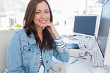 Attractive designer smiling in creative office