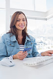 Pretty woman purchasing online with her credit card