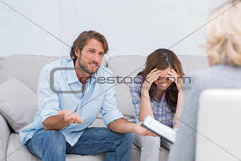Couple arguing and crying on the couch