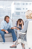 Therapist listening to the couple sit on the couch