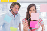 Woman pointing a sticky note