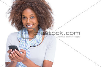 Attractive brunette typing a text message