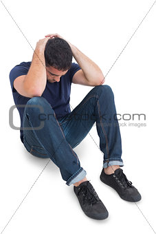 Sitting upset man with hands behind head