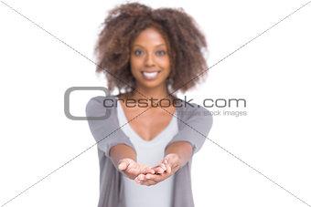 Smiling brunette holding her hands out