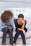Woman crying next to her therapist