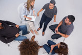 Patients listening to each other in group session