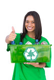 Enivromental activist holding box of recyclables and giving thumbs up