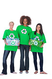 Three enivromental activists with two holding boxes of recyclables