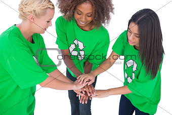 Three enviromental activists putting their hands together